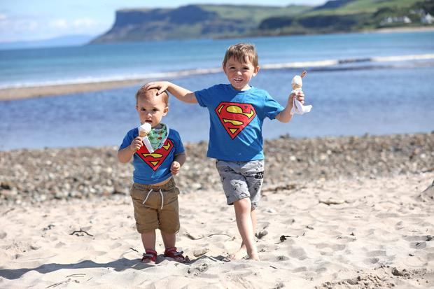 Jack and Joanah Denny enjoy an ice-cream during the warm weather on Ballycastle beach. Photo by Peter Morrison
