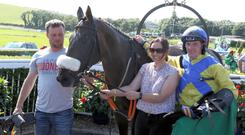 First class: Trainer Neil McKnight with Greenandwhitearmy, wife Christine and Ricky Doyle