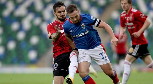 Breaking through: Jamie Mulgrew goes on the offensive against HB Torshavn in an earlier qualifying round of the Europa League