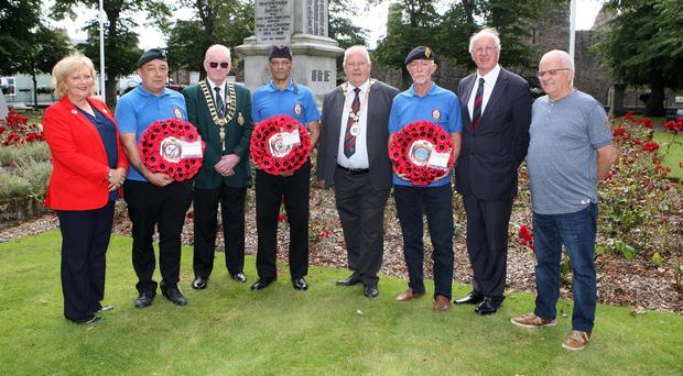 Annmarie Hastings of Beyond the Battlefield; Eric Larkin; David Forsy, chairman Newtownards RBL; Sean Pieres; mayor Bill Keery, Ards and North Down Borough Council; Dave Wilman; Jim Shannon MP, and councillor James Menagh