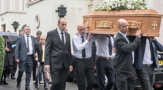 The funeral of Pat Gillespie who died at the weekend aged 102 years old. Picture Martin McKeown. 27.08.19