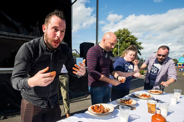 Pictured Sunday Life reporter John Toner during a hot wing challenge at The Doyen. (Liam McBurney/RAZORPIX)
