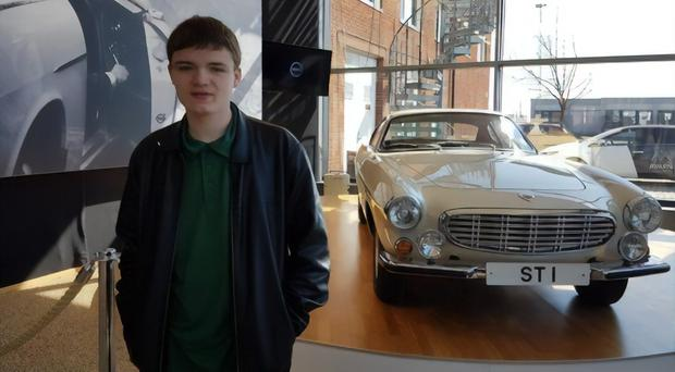 Evan Biggerstaff has made the final of the Young Driver Challenge 2019. He is pictured with the car from Roger Moore's classic television series 'The Saint'.