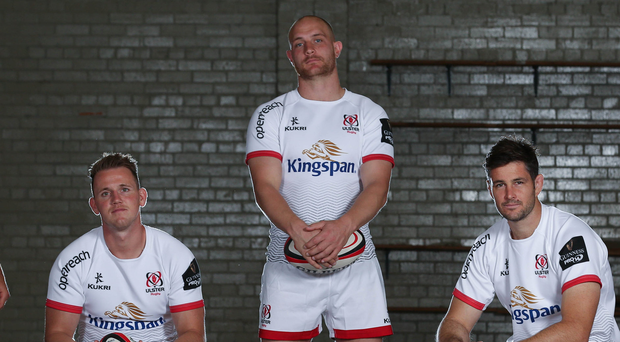 Kitted out: (from left) Craig Gilroy, Matt Faddes and Sam Carter show off the new Ulster shirt, which features a wave pattern made up of the nine counties of the province