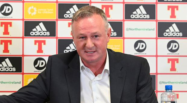 Job in hand: Michael O'Neill announces his NI squad yesterday