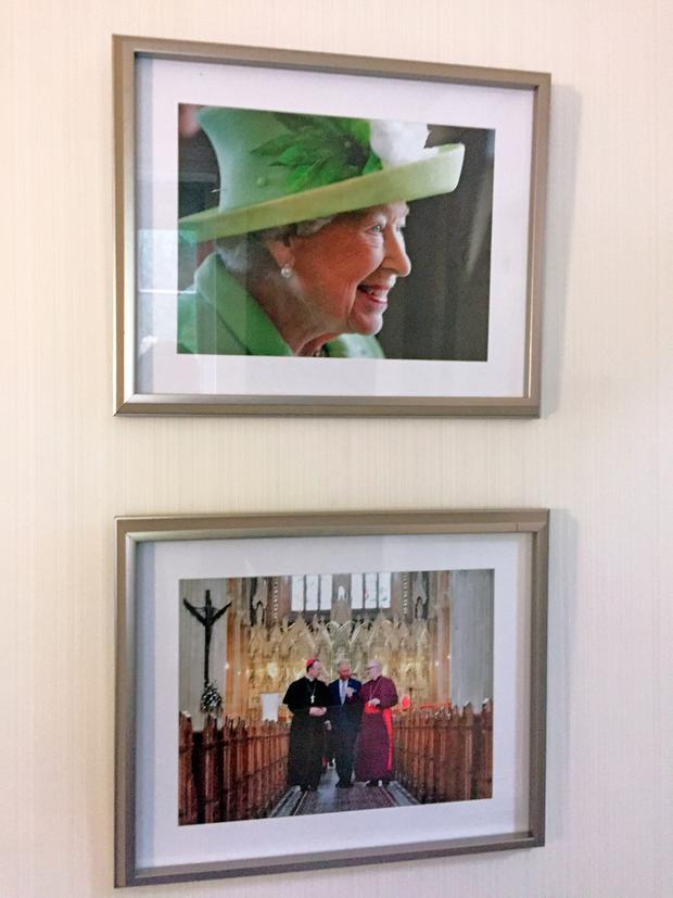 Photographs of Queen Elizabeth II, which have returned to the walls of a Government building in Belfast after its controversial removal. Pic: David Young/PA Wire