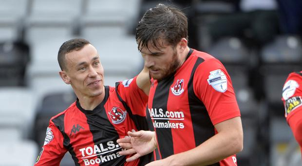 Philip Lowry scored twice as Crusaders saw off Dungannon Swifts in the top two clash at Seaview.