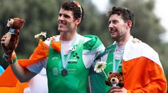 Philip Doyle, left, and Ronan Byrne of Ireland pose with their medals after finishing second in the Men's Double Sculls final at the World Rowing Championships in Ottensheim, near Linz, Austria, Sunday, Sept. 1, 2019. (AP Photo/Matthias Schrader)