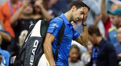 Pain game: Novak Djokovic leaves the court after withdrawing