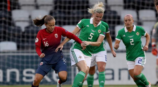 Turning away: Northern Ireland's Julie Nelson with Norway's Guro Reiten during Friday night's clash at Seaview