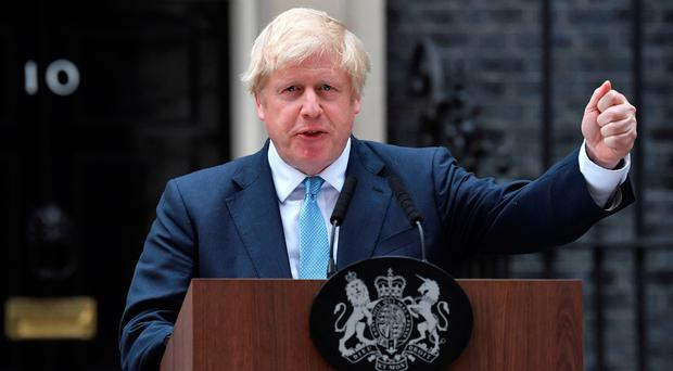 Johnson threatens rebel Tory MPs with snap election