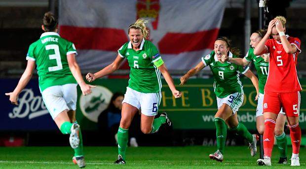 NEWPORT, WALES - SEPTEMBER 03: Ashley Hutton of Northern Ireland celebrates scoring her sides second goal in added time during the UEFA Womens Euro Qualifier match between Wales and Northern Ireland at Rodney Parade on September 03, 2019 in Newport, Wales. (Photo by Alex Davidson/Getty Images)