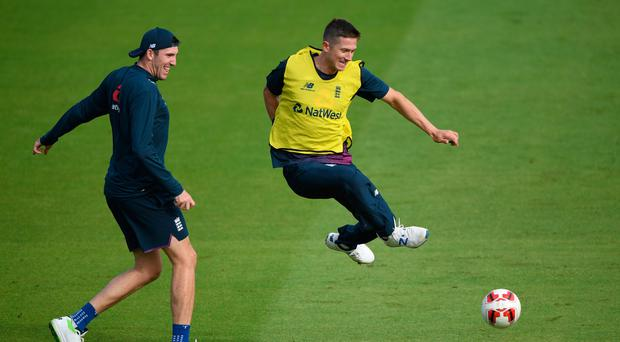 Ball game: Craig Overton (left) and Joe Denly warm up during training