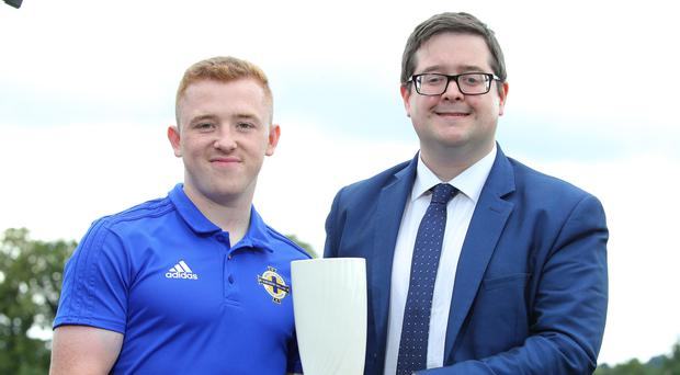Top man: Shayne Lavery receives his Player of the Month prize from Keith Bailie of the NIFWA committee