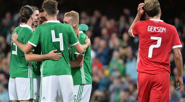 Northern Ireland's players celebrate what proved to be a match-winning own goal.