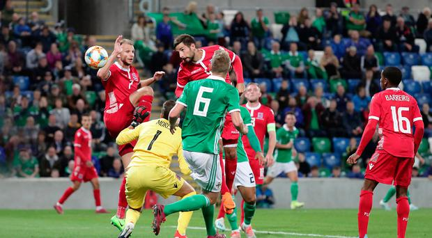 Moment of calamity: Luxembourg's Kevin Malget heads into his own goal last night