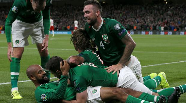 Republic of Ireland celebrate David McGoldrick's late equaliser (Brian Lawless/PA)