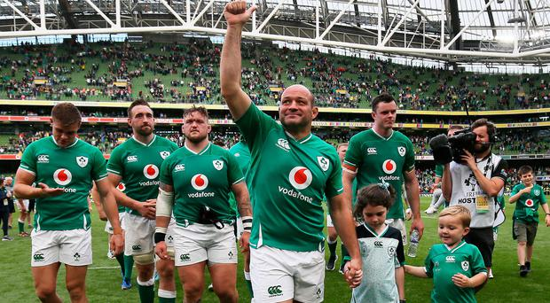 Ireland captain Rory Best leaves the pitch with his children and team-mates after winning his last home match at the Aviva Stadium, Dublin. Brian Lawless/PA Wire.