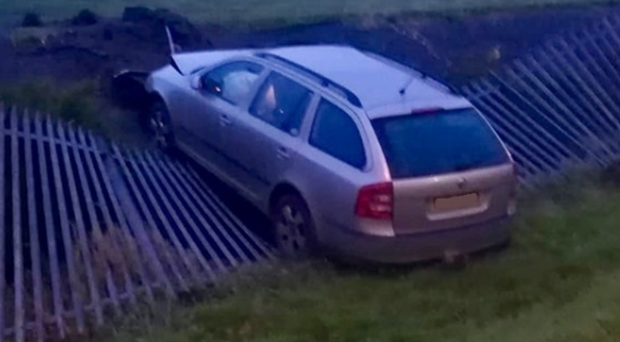 A car crashed into a fence in Dungannon. Credit: PSNI