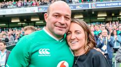 Rory Best is joined by his wife Jodie after his final appearance at the Aviva Stadium
