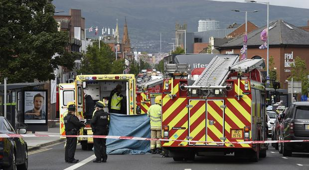 The scene on the Newtownards Road, East Belfast with the air ambulance in attendance where it is believed a pedestrian was struck by a heavy goods vehicle. Picture: Michael Cooper