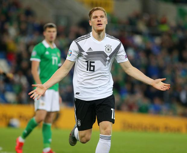 Should have been us: Northern Ireland missed some huge chances before Marcel Halstenberg opened the scoring for Germany.