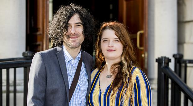 Emma DeSouza and her husband Jake outside the Royal,Court's of Justice in Belfast (Liam McBurney/PA)