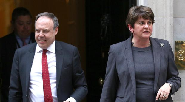 Nigel Dodds and Arlene Foster leave Downing Street (Aaron Chown/PA)