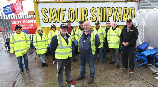Harland and Wolff shipyard workers in high spirits after an announcement that a consortium which includes Harland and Wolff has won a £1.25bn contract to build five warships for the Royal Navy.