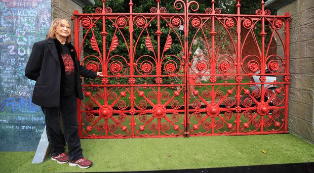 Julia Baird, John Lennon's sister and honorary president of the Strawberry Field project, with the original Strawberry Field gates ahead of the opening of the former children's home to the public (Peter Byrne/PA)