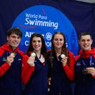 Thomas Hamer, Jessica Applegate, Bethany Firth and Reece Dunn show off their gold medals after winning the Mixed 4x100m Freestyle Relay S14.