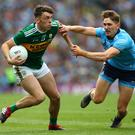 All action: Kerry's David Clifford and Dublin's Michael Fitzsimons battle it out two weeks ago in the drawn All-Ireland final at Croke Park in Dublin