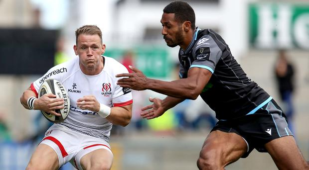 Ulster's Craig Gilroy is tackled by Ratu Tagive of Glasgow (INPHO/Bryan Keane)