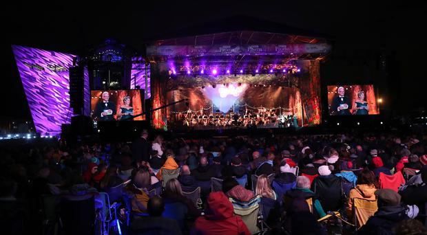 Some of the thousands of promenaders gathered at the Titanic Slipways in Belfast for this year's BBC Proms In The Park Northern Ireland.
