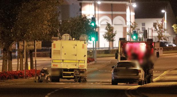 Police at the scene near Antrim Police Station. Photo by Kevin Scott