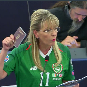 Martina Anderson wears James McClean's Ireland football jersey in the European Parliament