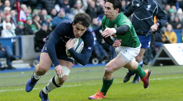 Scotland's Sam Johnson is looking to knock Ireland off their throne on Sunday (Graham Stuart/PA)