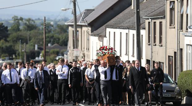Family and friends carry the coffin of Max Wilson (17) into the Third Presbyterian Church, Rathfriland. Photo by Peter Morrison