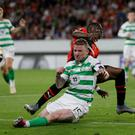 Celtic's Jonny Hayes, front, is tackled by Rennes' Hamari Traore during the Europa League Group E match Credit: AP Photo/David Vincent