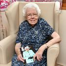 Maud Nicholl celebrates her 110th Birthday with family and friends at Glenkeen nursing home in Randalstown Wednesday. Credit: Colm Lenaghan/Pacemaker