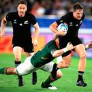 New Zealand's George Bridge (right) breaks away during the 2019 Rugby World Cup Pool B match at International Stadium Yokohama, Yokohama City.
