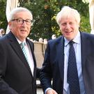 Prime Minister Boris Johnson is greeted by European Commission President Jean-Claude Juncker, outside Le Bouquet Garni restaurant in Luxembourg, prior to a working lunch on Brexit (PA)