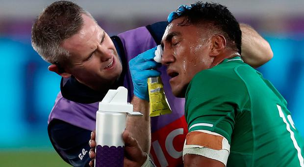 Bundee Aki receives treatment before being forced off for an HIA.