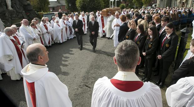 The funeral cortege of the late Most Reverend Dr. Seamus Hegarty, former Bishop of Derry and former Bishop of Raphoe, makes its way to its resting place in the grounds of St Eugene's Cathedral.