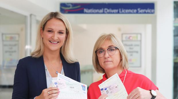 Chief executive of the Road Safety Authority Moyagh Murdock (right) and Minister of State for European Affairs Helen McEntee during a visit the National Driver Licence Service in Santry, Dublin (Niall Carson/PA)