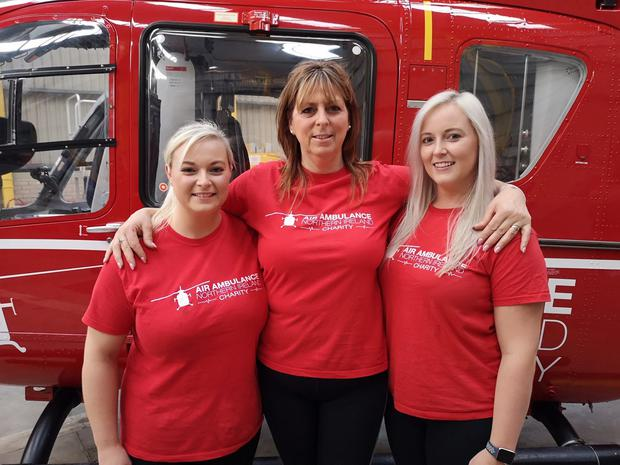 A family in County Armagh has raised almost £10,000 for the charity Air Ambulance Northern Ireland in memory of their late father Jim Russell. Pictured are Jim's daughters Diane Murdoch and Kerri Russell as well as their mum and Jim's wife, Linda Russell.