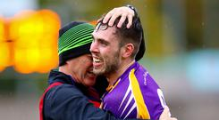 High five: Derrygonnelly ace Ryan Jones celebrates fifth straight county title with assistant boss Brendan Rasdale