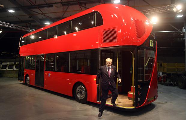Boris Johnson, then mayor of London, unveils a life-size mock-up of the new hop-on, hop-off double-decker bus for London (Lewis Whyld/PA)