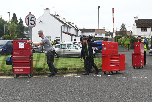 Workers at Wrightbus in Ballymena leave with personal tools on Wednesday. Credit: Colm Lenaghan/Pacemaker