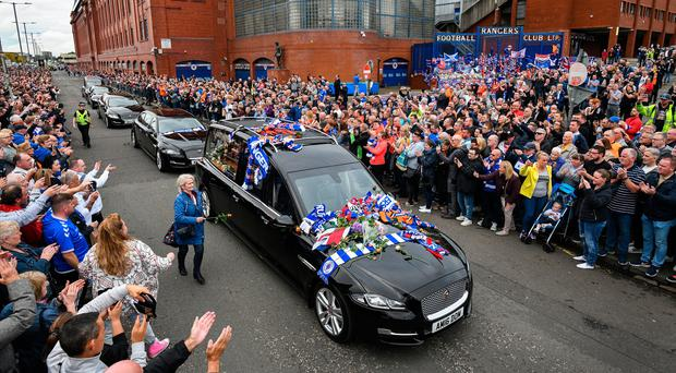 Rangers fans and players gathered to pay tribute to Fernando Ricksen outside the club's Ibrox stadium.